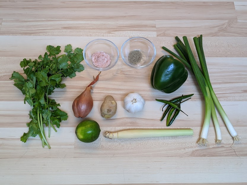 Thai Green Curry paste ingredients laid out on wooden background