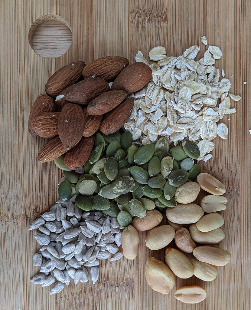 Whole nuts and seeds (almonds, pumpkin seeds, oats, peanuts and sunflower seeds) before chopping