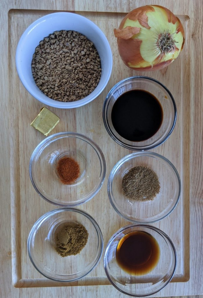 Raw ingredients of dehydrated veggie backcountry bolognese dish - onion, stock cube, tvp, soy sauce, spices and Worcestershire sauce