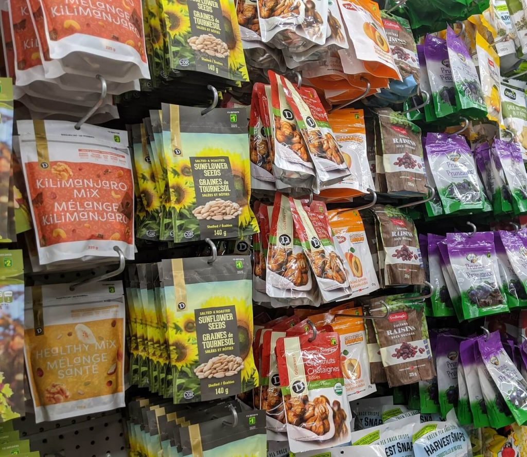Side view of seed and nut packages in dollar store